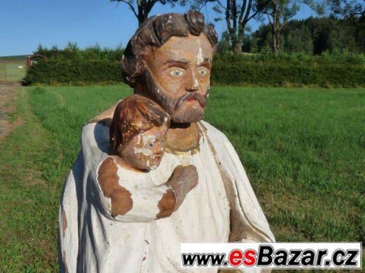 Svatý Josef chová malého