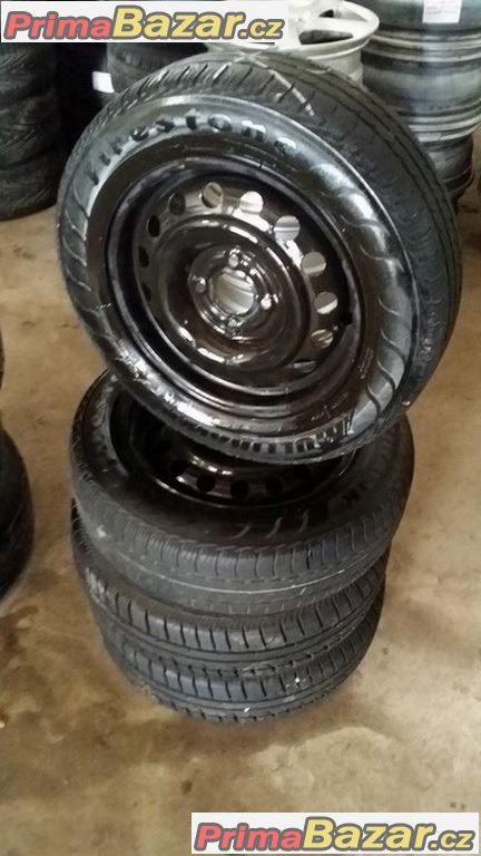 Plechove disky VW 4x100 2xnove pneu Fulda 165/70 r14 81T r.v.2014