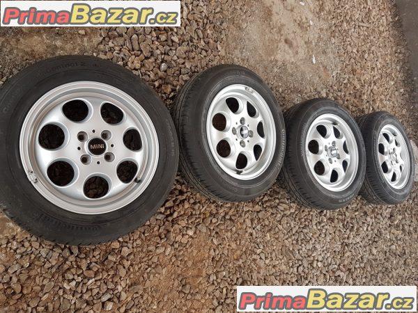 zánovní sada Mini Cooper s zánovní pneu Continental 4x100 5.5jx15 et45
