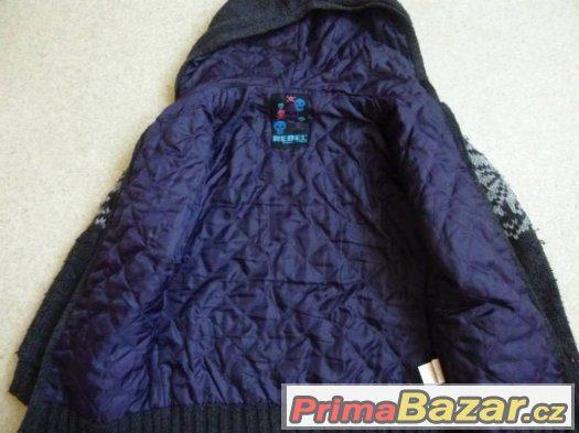 vypodšitá svetro bunda