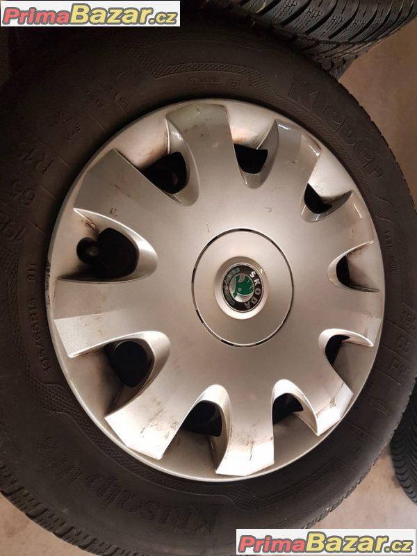 Plechove disky s pneu a poklicema Škoda 1K0601027C 5x112 6jx15 et