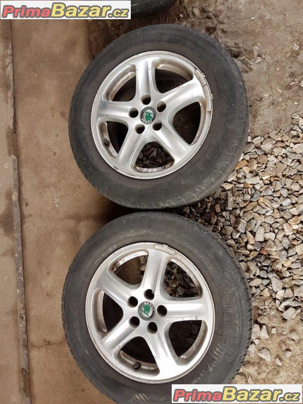 sada octavia 1 s pneu na dojeti 1U0601025 5x100 6jx15 et38