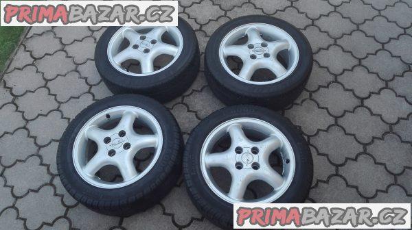 Originální alu kola Opel Tigra + letní pneu (4mm)