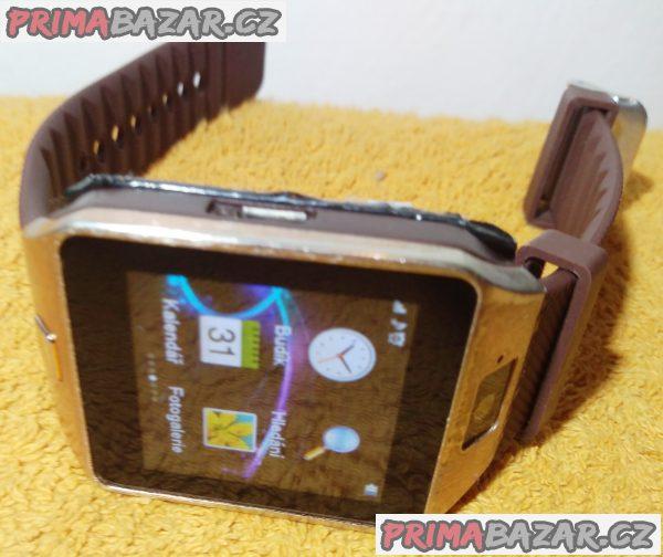 Mobil v hodinkách skamerou, bluetooth a microSD slotem!!!