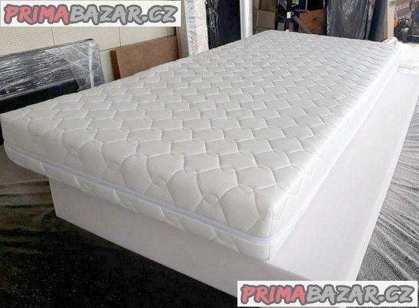 postel s roštem, matrací + velkým úložným prostorem.